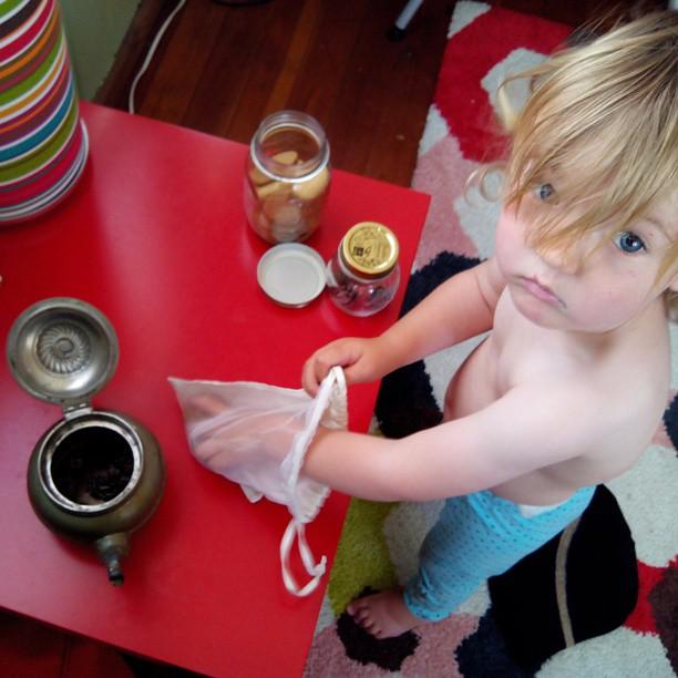 Jars, pinecones, bamboo pebbles & a tea pot.