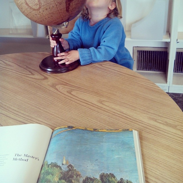 At the library: Cezanne for me, globe for her