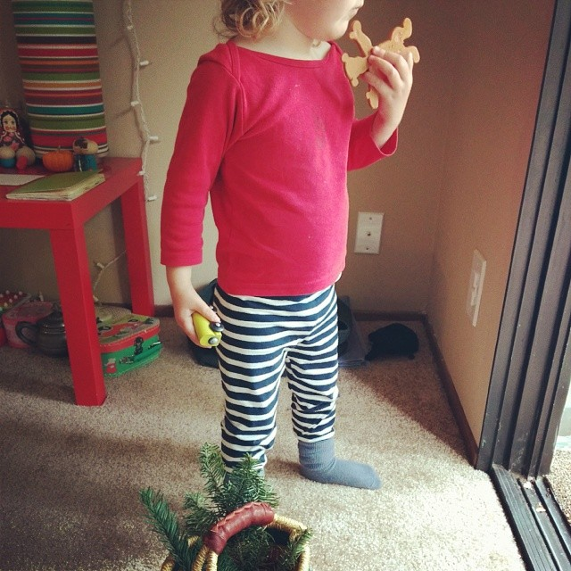 my little elf and her basket of fir branches