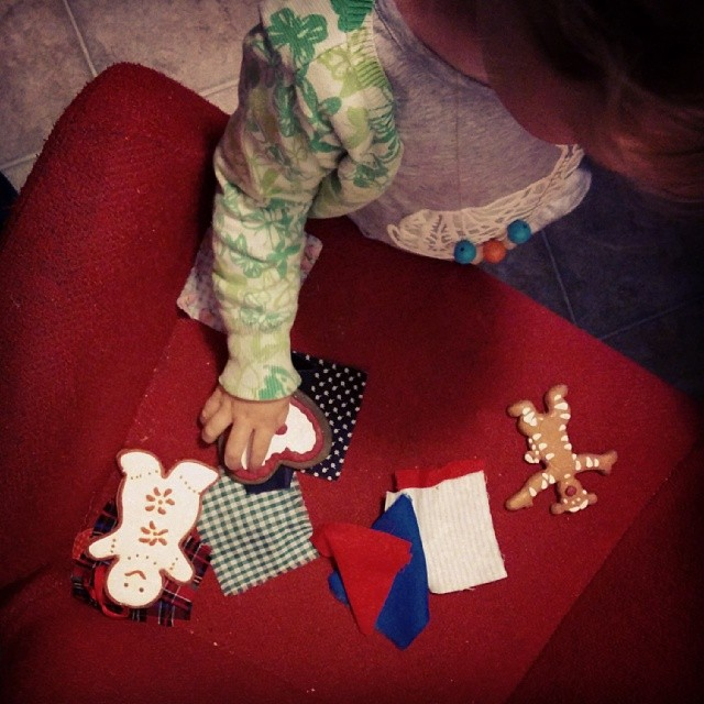 A collection: fabric squares and gingerbread ornaments.