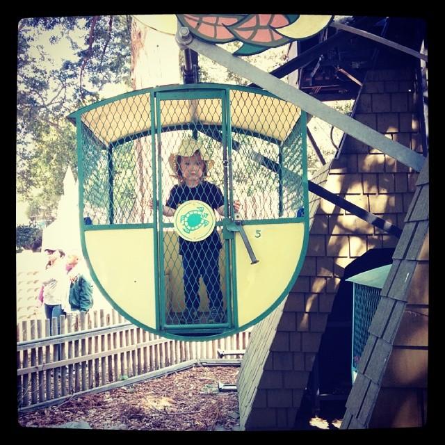 Testing boundaries, even on the Ferris wheel.