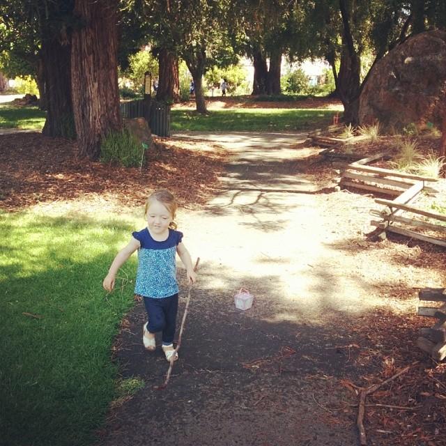 Running through sprinklers in the gardens
