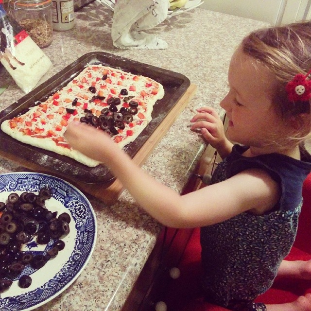 helping with pizza prep