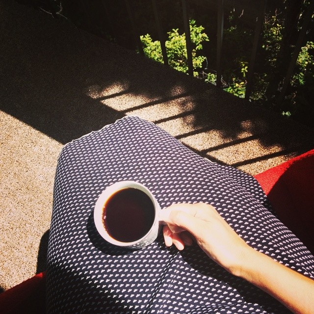 Having coffee outside on our balcony