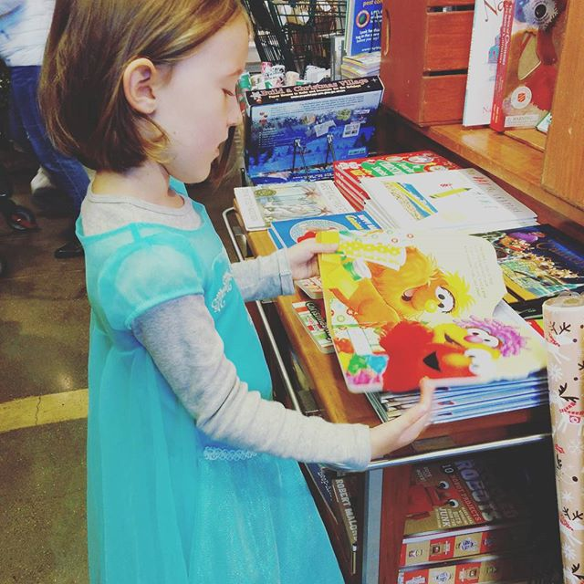 Always in dress up. Always reading books. Even in Whole Foods.