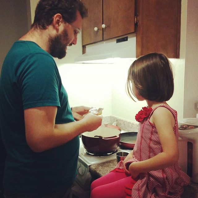 showing her how he is making Japanese curry