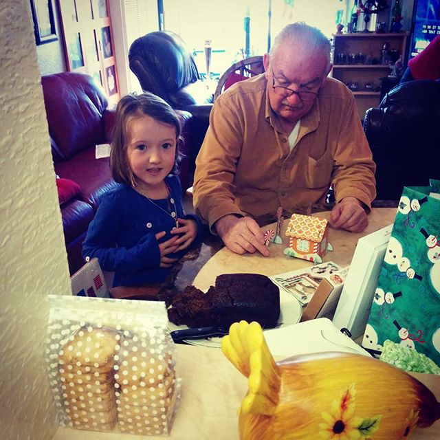 Emma & Grandpa making a pop out gingerbread house