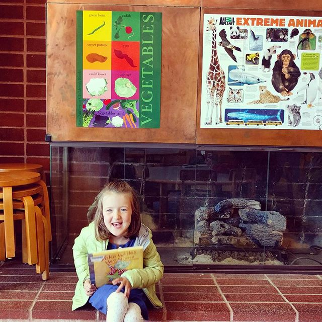 Reading books at the beautiful Parkside library branch.
