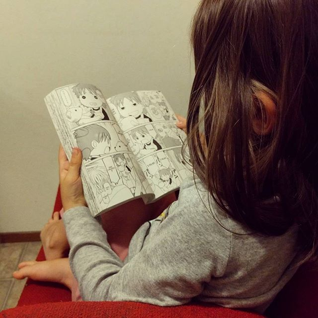 Reading Yotsuba, her favorite manga. maiki and Clover read them every night at bedtime.
