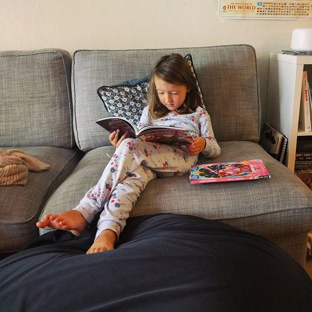 reading comic books in her pajamas