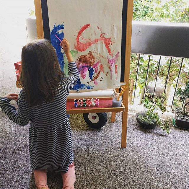 painting while humming to herself