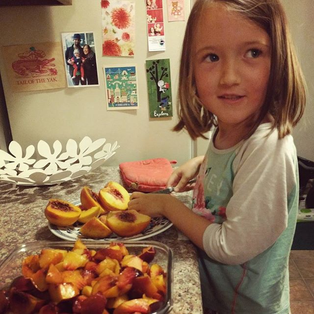 Cutting peaches & nectarines from our csa. Maybe pie tomorrow.