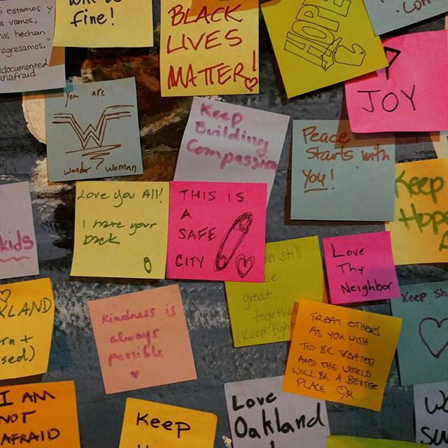 a huge wall with small messages of hope