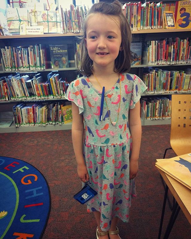 She got her own library card today!