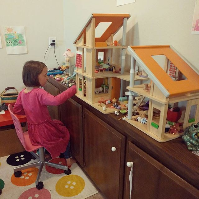 She rolls along her dollhouse and Calico Critters.