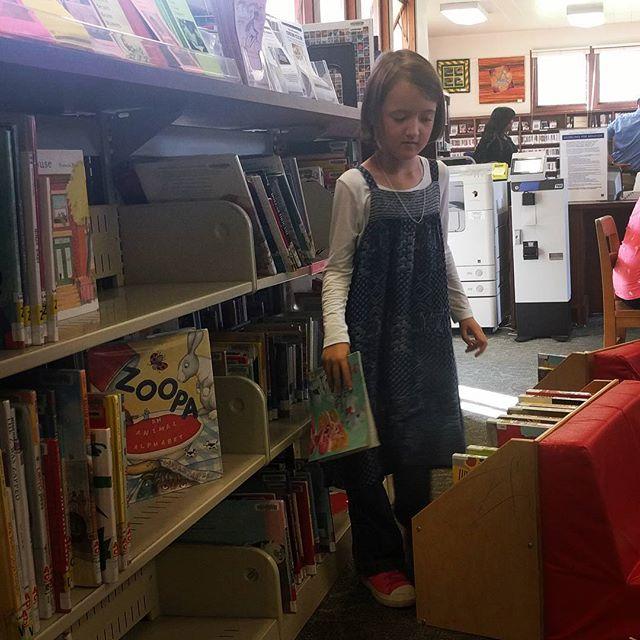 Found Clover alphabetizing books as she returned them them shelves.