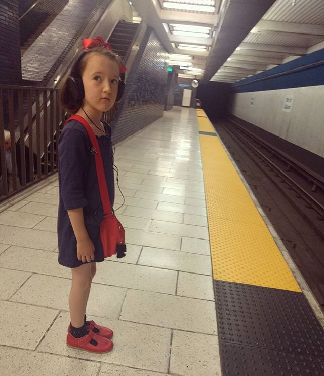 Going to a homeschool Halloween party in Berkeley. I like this modern interpretation where she wears headphones and rides BART.