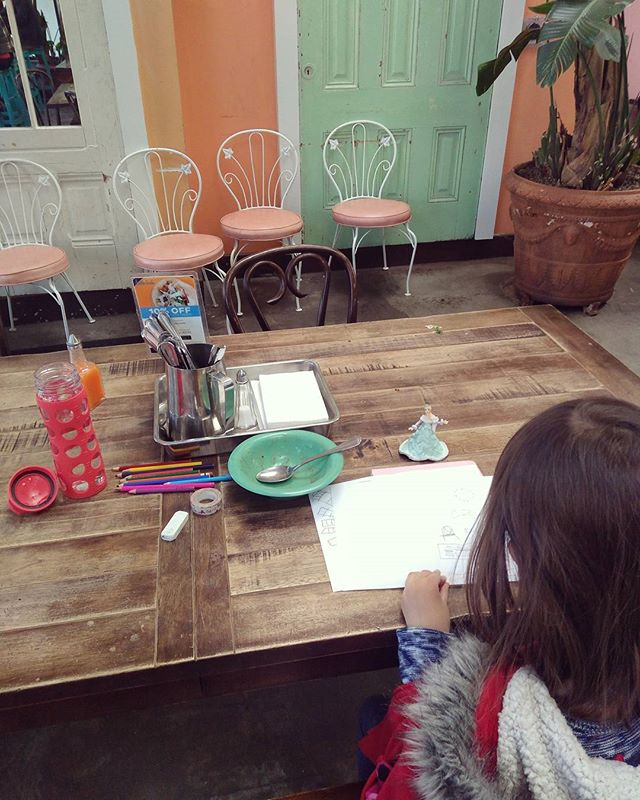 Working on a times of day book while eating rice and beans. Em is drawing our lunch table!