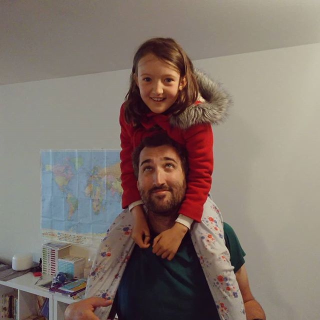 Way up high on papa's shoulders