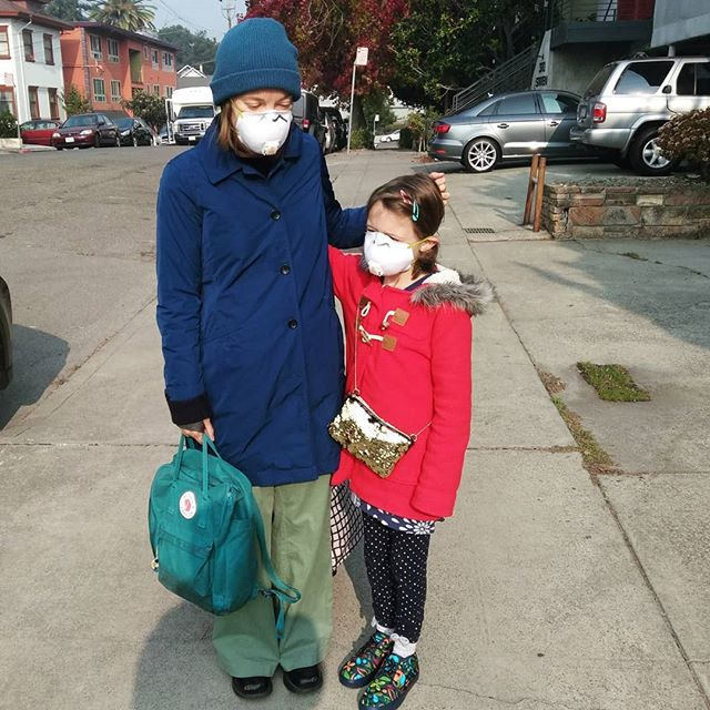 Wearing our masks so we can walk outside.