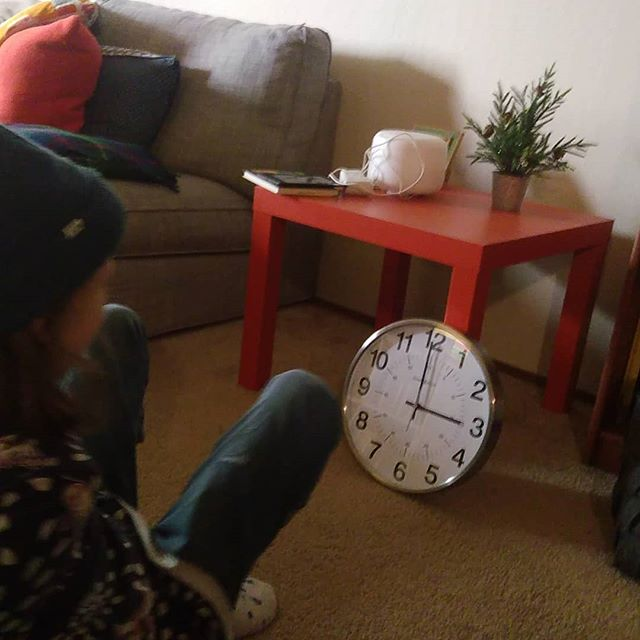 Literally watching the clock. This was my present for our home, a classic wall clock from Design Within Reach.